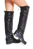Shapely female legs in high leather boots side view Stock Photo