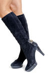 Shapely female legs in high suede boots side view Stock Photo