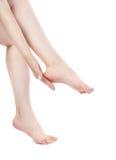 Shapely female legs. Isolation on a white background. Royalty Free Stock Photos