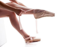 Shapely female legs in pointes, close-up. Image of shapely female legs in pointes, close-up Royalty Free Stock Photography