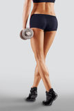 Shapely female legs in sporting black shorts Royalty Free Stock Image