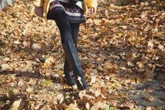 Shapely female legs walking on autumn yellow foliage Stock Photo