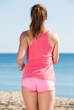 Shapely girl jogging at seaside Royalty Free Stock Images