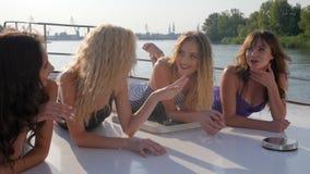 shapely girlfriends swimsuit talking lying deck yacht river shapely girlfriends swimsuit talking lying deck 113195392