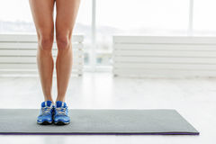 Shapely legs of active woman Stock Photography