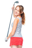 Shapely successful girl with a golf club on a white. Background Royalty Free Stock Photography