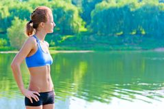 Shapely, toned woman in sportswear rest. On the nature Royalty Free Stock Photos