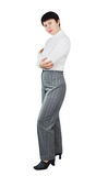 Shapely Woman Dressed In White Knitted Turtleneck And Grey Trousers Stock Photography