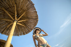 Shapely woman enjoying a tropical summer vacation Royalty Free Stock Photography