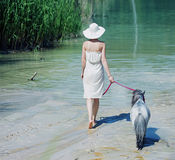 Shapely woman walking with the pony Stock Photo