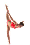 Shapely young woman doing gymnastics splits Royalty Free Stock Photo