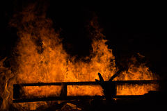 Shapes in Fire. This was a bonfire I was photographing where a wooden pallet was the base of the fire. The pallet was still pretty sturdy and maintained the Stock Photo
