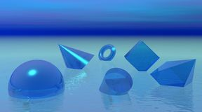 Shapes floating in blue ocean Royalty Free Stock Image
