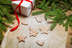 Shapes of gingerbread cookies on a piece of paper and icing suga Stock Photography