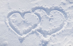 The shapes of heart on the snow. Stock Photo