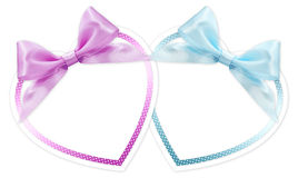 Shapes of hearts with pink and blue ribbon bow isolated Royalty Free Stock Photos