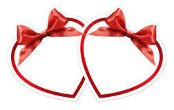 Shapes of hearts with red bow  on white Stock Photo