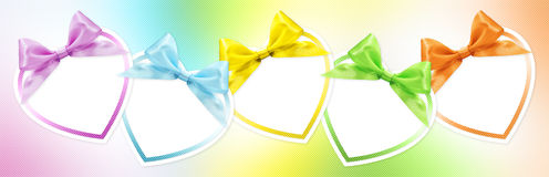 Shapes of hearts in various colors. Whit ribbon bow Royalty Free Stock Image