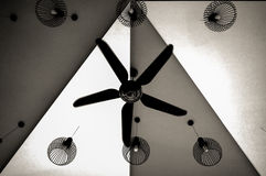 Shapes. The shapes of lamp and fan hanging from ceiling Royalty Free Stock Image