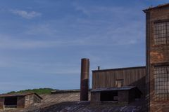 Shapes and textures of industrial buildings against a blue sky. Horizontal aspect stock photography