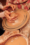 Shaping cay on pottery wheel Royalty Free Stock Images