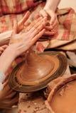 Shaping cay on pottery wheel Royalty Free Stock Photos