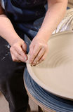 Shaping clay. Close-up of hands shaping a pot on a wheel Stock Photo