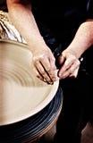 Shaping clay With Holga Look Royalty Free Stock Photos