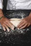 Shaping the floured dough Stock Photos
