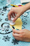 Shaping fondant butterflies. Cutting butterflies with a special fondant tool Royalty Free Stock Photography