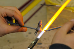 Shaping glass in fire Stock Image