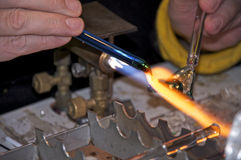 Shaping glass in fire Stock Photos