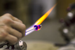 Shaping glass over a flame Stock Image