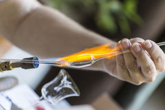 Shaping a piece of glass Stock Photography