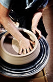Shaping pottery with Holga Loo Royalty Free Stock Images