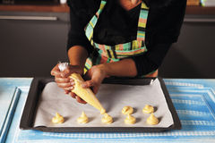 Shaping the puff pastries with a piping bag Royalty Free Stock Photo