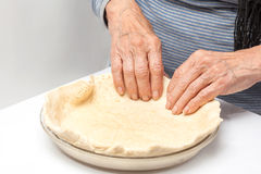 Shaping the quiche Lorraine dough into the baking dish Stock Photo