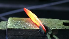 Shaping of metal part in blacksmith workshop stock video