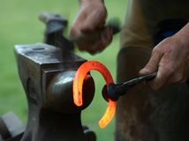 Shaping the Shoe. Farrier shaping a hot horseshoe Royalty Free Stock Images
