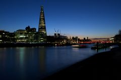 Shard building, HMS Belfast, London Bridge at dusk Royalty Free Stock Image