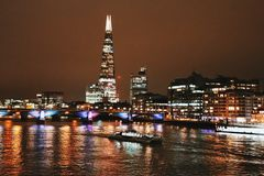 The Shard building and Thames  by night, London, England, UK. The night view from Millenium bridge in London on the highest building in Europe, the Shard, Thames Stock Images