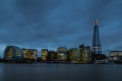 The Shard & City Hall, London at dusk. The awe inspiring Shard, Londons tallest building at over 300m, and City Hall, Major of Londons skriking glass office ( Stock Photo