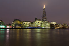 Shard, City Hall and Other Buildings at Night. LONDON, UK - 9TH MARCH 2015: The Shard, City Hall, More London and other buildings from across the River Thames at Stock Photo