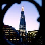 The Shard at dusk. Framed using ironwork on Tower Bridge. Royalty Free Stock Images