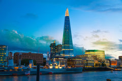 Shard of glass and office buildings in twilight. London Stock Image