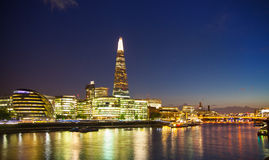 Shard of glass and office buildings in twilight. London Stock Photography