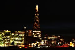 London at night. The Shard of Glass skyscraper built in Neo futurism architectural style. The Shard of Glass is a 95-storey skyscraper, situated in Southwark royalty free stock images