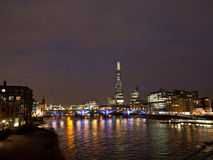 The Shard in London. Southwark Bridge and the Shard in London night scene royalty free stock photos