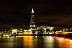 The Shard and London Bridge at Night. London Cityscape: The Shard, public London Bridge Hospital and London Bridge at Night Royalty Free Stock Photography