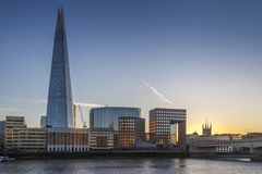 The Shard and London Bridge by river Thames during sunset. The Shard and London Bridge by river Thames during golden light sunset Stock Images